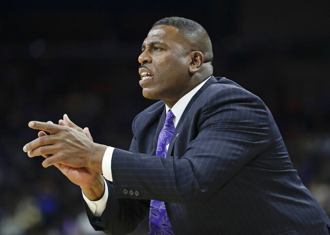 LSU interim head coach Tony Benford shouts to his players during the first half of a second-round game against Maryland in the NCAA men's college basketball tournament in Jacksonville, Fla., Saturday, March 23, 2019. (AP Photo/John Raoux)