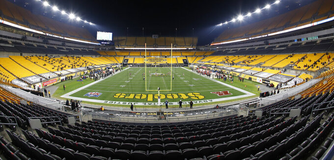 Empty end zone seats and a few of the limited number of fans attending an NFL wild-card playoff football game between the Pittsburgh Steelers and the Cleveland Browns are seen at Heinz Field, Sunday, Jan. 10, 2021, in Pittsburgh. (AP Photo/Keith Srakocic)