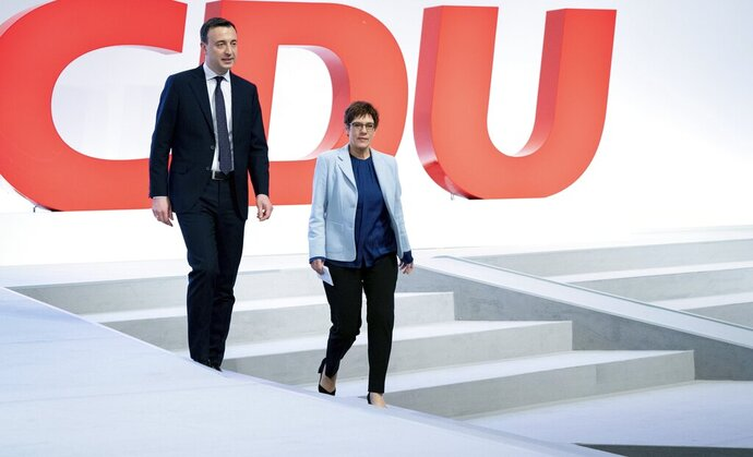 Annegret Kramp-Karrenbauer, right, chairwomen of the German Christian Democratic party (CDU), and the party's secretary general Paul Ziemiak, left, arrive for a venue walkabout in Leipzig, Germany, Thursday, Nov. 21, 2019 prior to this week's CDU party convention in Leipzig. (Kay Nietfeld/dpa via AP)
