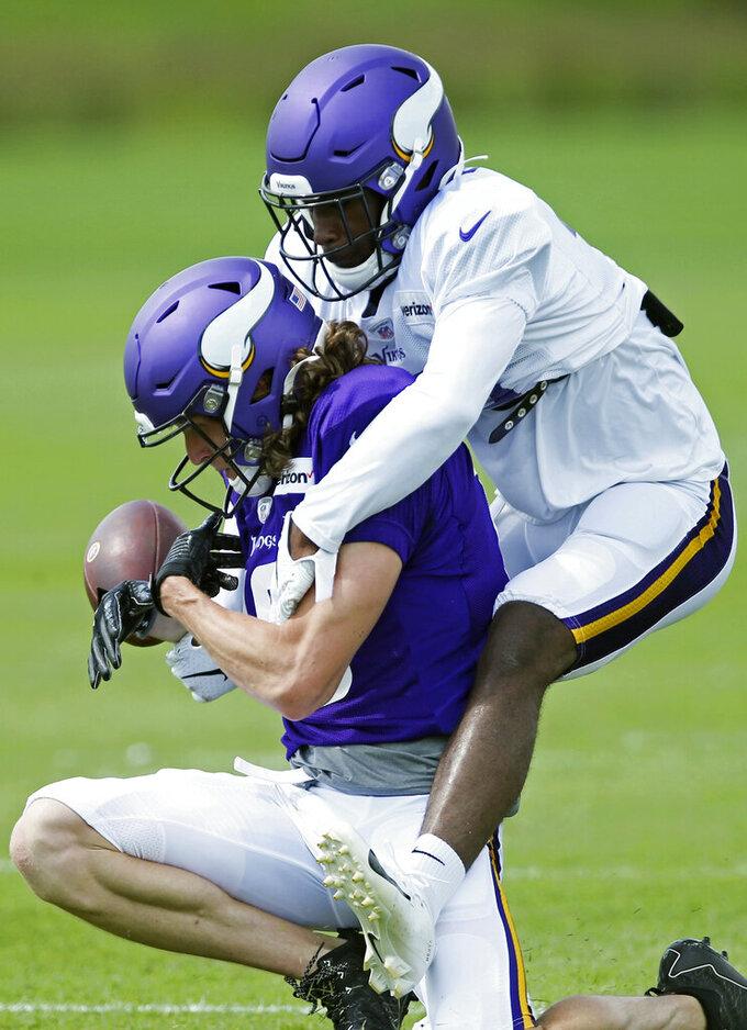 Minnesota Vikings cornerback Kris Boyd, top, breaks up a pass to wide receiver Jordan Taylor during the NFL football team's training camp Monday, July 29, 2019, in Eagan, Minn. (AP Photo/Jim Mone)