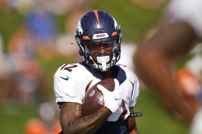 Denver Broncos wide receiver Trinity Benson takes part in drills during an NFL football training camp at the team's headquarters Tuesday, Aug. 17, 2021, in Englewood, Colo. (AP Photo/David Zalubowski)