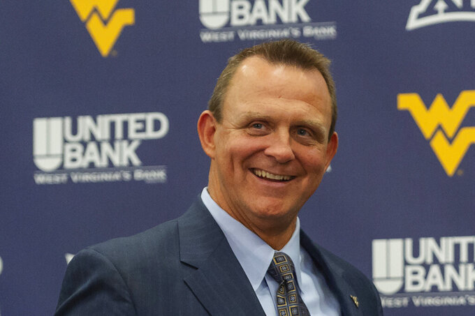 FILE - In this Thursday, Jan. 19, 2019, file photo, West Virginia University Director of Athletics Shane Lyons is shown at a press conference in Morgantown, W.Va. Whether college football players play a lot in the fall, a little in the spring or not all over the next 10 moths, some athletic administrators want to give them a mulligan on the 2020-21 season. Because of the uncertainty and so many variables, West Virginia athletic director Shane Lyons, who is part of the NCAA DI Council, would like to allow athletes in all fall sports to get an extra year of eligibility and competition, regardless of how much they play and when. (Craig Hudson/Charleston Gazette-Mail via AP, File)