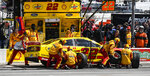 Driver Joey Logano's pit crew service his car during a NASCAR Cup auto race at Texas Motor Speedway, Sunday, March 31, 2019, in Fort Worth, Texas. (AP Photo/Larry Papke)