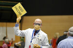 FILE - In this Jan. 24, 2021, file photo, Dr. John Corman, the chief clinical officer for Virginia Mason Franciscan Health, holds a sign that reads