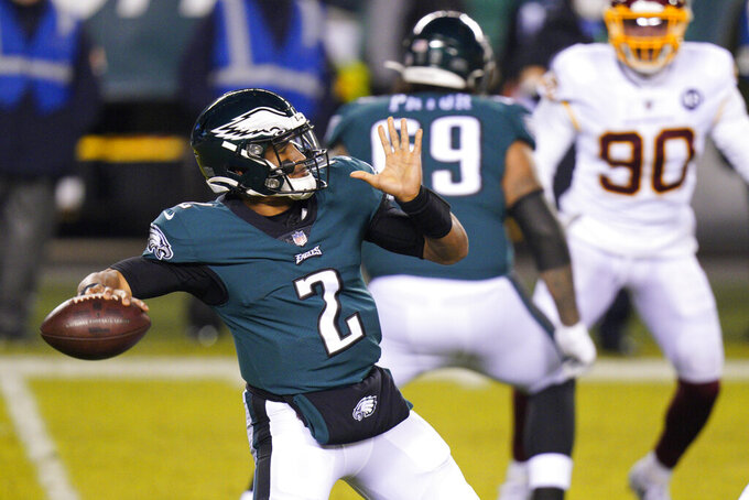 Philadelphia Eagles' Jalen Hurts passes during the first half of an NFL football game against the Washington Football Team, Sunday, Jan. 3, 2021, in Philadelphia. (AP Photo/Chris Szagola)