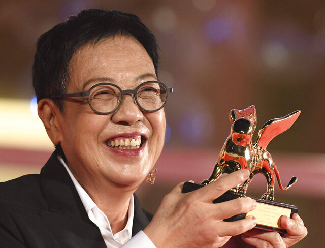 Director Ann Hui holds her Golden Lion award for Lifetime Achievement during the 77th edition of the Venice Film Festival in Venice, Italy, Tuesday, Sept. 8, 2020.(Piergiorgio Pirrone /LaPresse via AP)