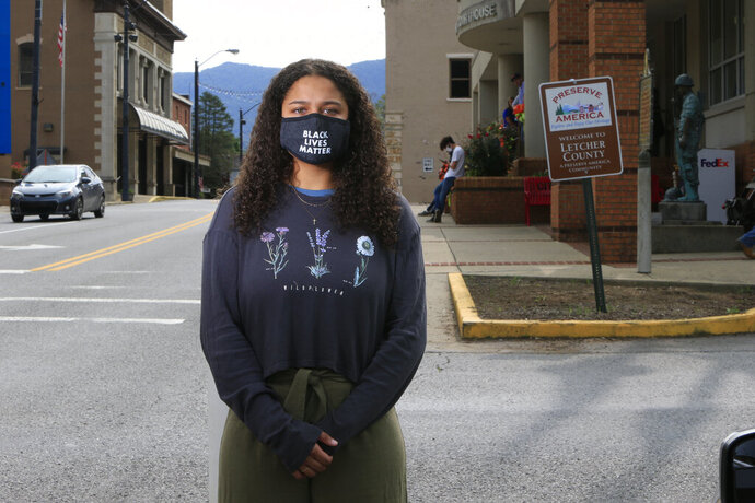 Dayja Hogg, 19, stands for a portrait in front of her home town's courthouse on Wednesday, Sept. 16, 2020, in Whitesburg, Ky. Following the deaths of George Floyd in Minneapolis and Breonna Taylor in Louisville, Hogg helped organize a protest in her home town of Whitesburg where she grew up experiencing racism. (AP Photo/Brian Blanco)