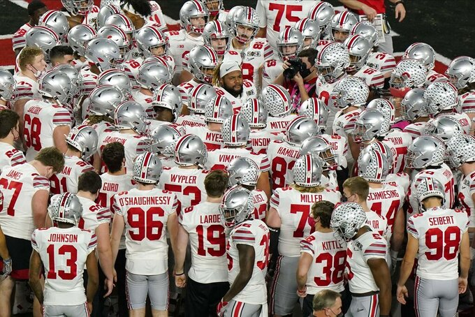 Ohio State gathers before an NCAA College Football Playoff national championship game against Alabama, Monday, Jan. 11, 2021, in Miami Gardens, Fla. (AP Photo/Wilfredo Lee)