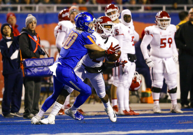 Fresno State wide receiver Michiah Quick, right, fights with Boise State safety Kekoa Nawahine (10) for the ball on a pass in the second half of an NCAA college football game, Friday, Nov. 9, 2018, in Boise, Idaho. Boise State won 24-17 over Fresno State. (AP Photo/Steve Conner)