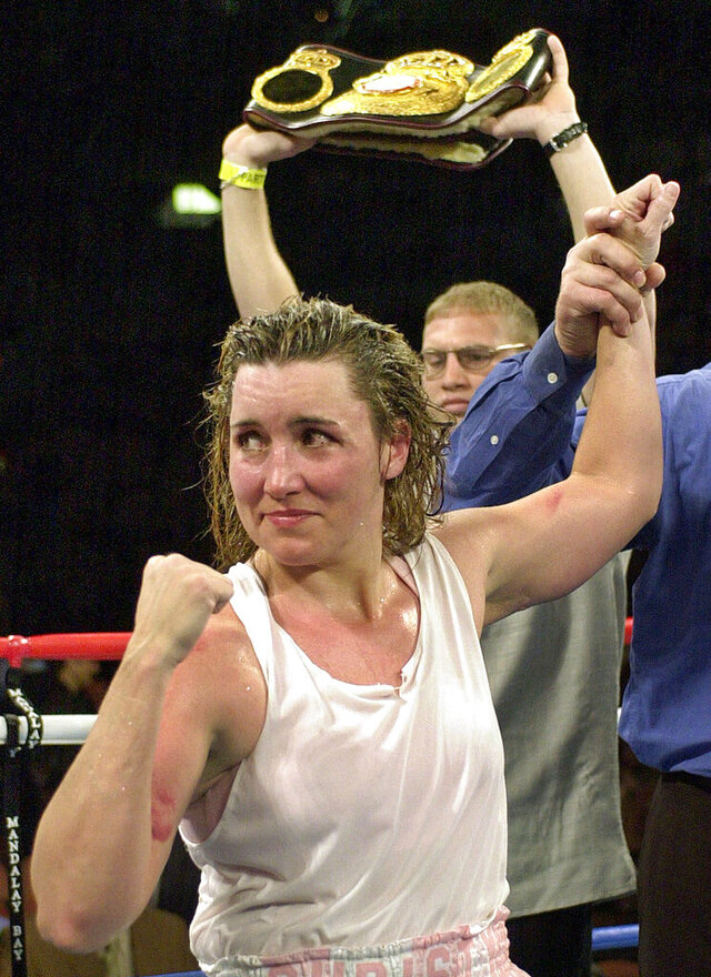 FILE - In this March 3, 2001, file photo, Christy Martin looks toward her corner following her unanimous 10-round decision over Jeanne