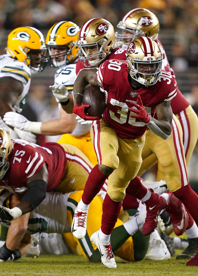San Francisco 49ers running back Jeff Wilson Jr. (30) runs against the Green Bay Packers during the first half of an NFL football game in Santa Clara, Calif., Sunday, Nov. 24, 2019. (AP Photo/Tony Avelar)