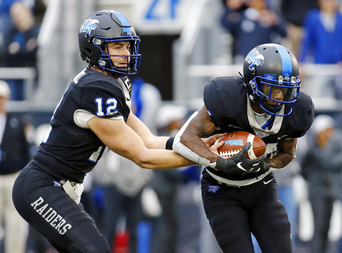 Middle Tennessee quarterback Brent Stockstill (12) hands off to wide receiver Zack Dobson during the second half against UAB in the Conference USA championship NCAA college football game Saturday, Dec. 1, 2018, in Murfreesboro, Tenn. UAB won 27-25. (AP Photo/Mark Humphrey)