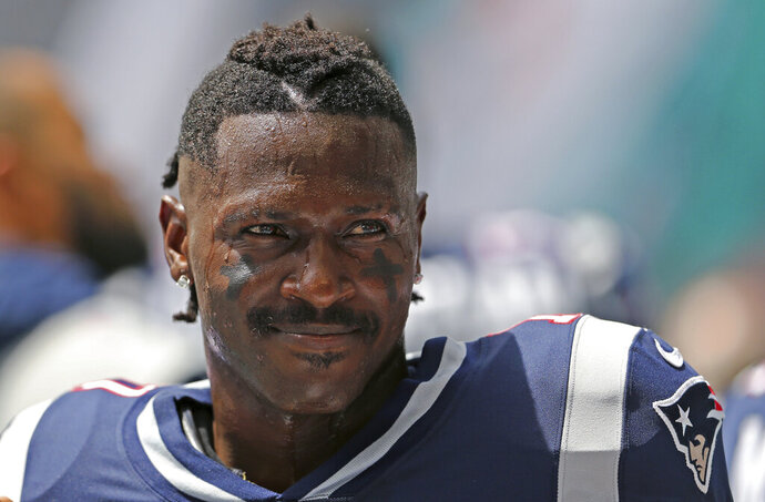 New England Patriots wide receiver Antonio Brown looks on before the start of an NFL football game against the Miami Dolphins at Hard Rock Stadium on Sunday, September 15 2019, in Miami Gardens. (David Santiago/Miami Herald via AP)