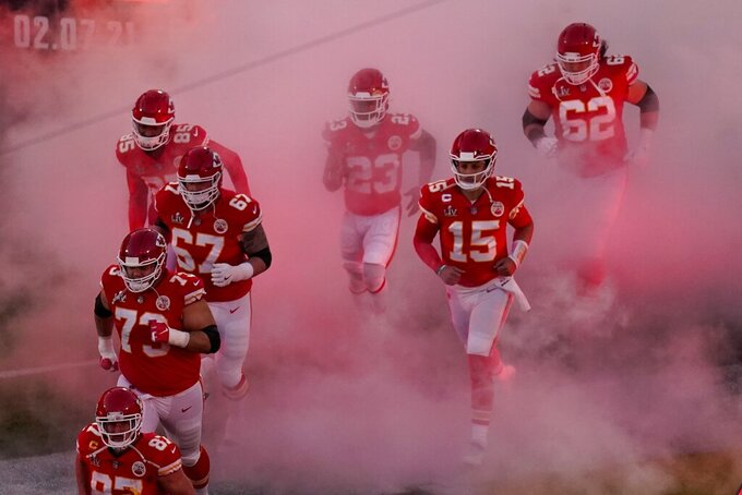 Kansas City Chiefs' Patrick Mahomes (15) and teammates run onto the field before the NFL Super Bowl 55 football game between the Kansas City Chiefs and Tampa Bay Buccaneers, Sunday, Feb. 7, 2021, in Tampa, Fla. (AP Photo/Charlie Riedel)