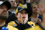 Boston Bruins fans watch the closing minutes of Game 5 of the NHL hockey Stanley Cup Final between the Bruins and the St. Louis Blues, Thursday, June 6, 2019, in Boston. (AP Photo/Michael Dwyer)
