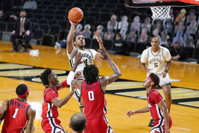 Vanderbilt's Jordan Wright (4) shoots over Mississippi's Romello White (0) in the first half of an NCAA college basketball game Saturday, Feb. 27, 2021, in Nashville, Tenn. (AP Photo/Mark Humphrey)