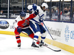Columbus Blue Jackets defenseman Michael Del Zotto, left, works against Tampa Bay Lightning forward Pat Maroon during the first period of an NHL hockey game in Columbus, Ohio, Tuesday, April 6, 2021. (AP Photo/Paul Vernon)