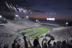 """Penn State takes the field for their NCAA college football game against Auburn amidst a """"Whiteout"""" crowd at Beaver Stadium  in State College, Pa., on Saturday, Sept. 18, 2021. (AP Photo/Barry Reeger)"""