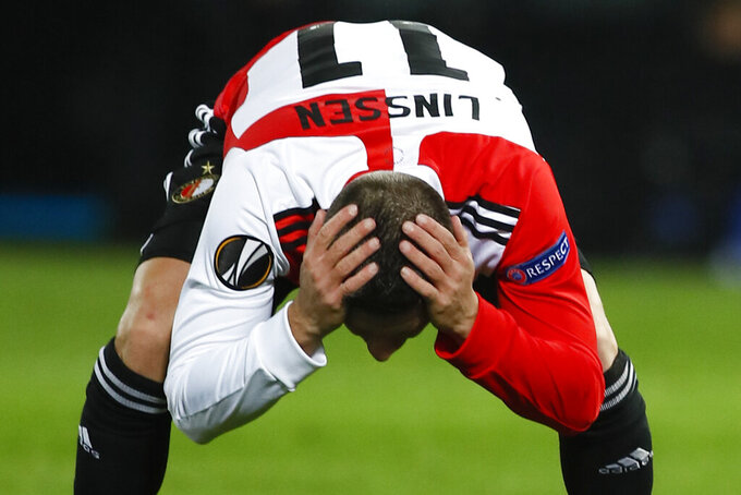 Feyenoord's Bryan Linssen holds his head after missing a chance to score during the Group K Europa League soccer match between Feyenoord and Wolfsberger AC at De Kuip stadium in Rotterdam, Netherlands, Thursday, Oct. 29, 2020. (AP Photo/Peter Dejong)