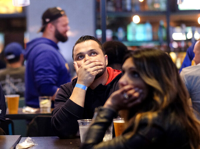 Fans react during a viewing party for the Super Bowl 53 football game between the New England Patriots and the Los Angeles Rams in Los Angeles, Sunday, Feb. 3, 2019. (AP Photo/Ringo H.W. Chiu)