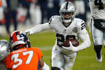 Las Vegas Raiders running back Josh Jacobs (28) runs for a touchdown against the Denver Broncos during the second half of an NFL football game, Sunday, Jan. 3, 2021, in Denver. (AP Photo/David Zalubowski)