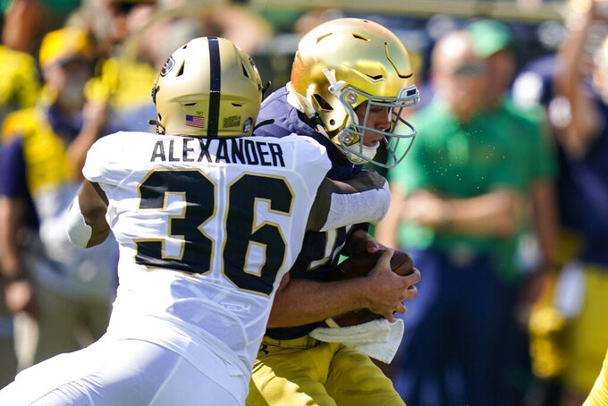 Purdue linebacker Jaylan Alexander (36) sacks Notre Dame quarterback Jack Coan (17) during the first half of an NCAA college football game in South Bend, Ind., Saturday, Sept. 18, 2021. (AP Photo/Michael Conroy)