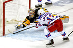 After losing his stick Pittsburgh Penguins goaltender Tristan Jarry (35) tries to make a save of a shot by New York Rangers' Alexis Lafreniere (13) during the first period of an NHL hockey game in Pittsburgh, Sunday, Jan. 24, 2021. (AP Photo/Gene J. Puskar)