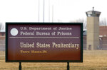 FILE - In this March 17, 2003 oil photo, a guard tower flanks the sign at the entrance to the U.S. Penitentiary in Terre Haute, Ind. After the latest 17-year hiatus, the Trump administration wants to restart federal executions this month at the Terre Haute, prison. Four men are slated to die. All are accused of murdering children in cases out of Arkansas, Kansas Iowa and Missouri. (AP Photo/Michael Conroy File)