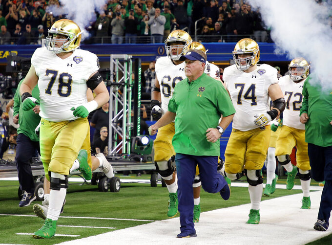 Notre Dame head coach Brian Kelly jogs onto the field for the first half of the NCAA Cotton Bowl semi-final playoff football game against Clemson on Saturday, Dec. 29, 2018, in Arlington, Texas. (AP Photo/Michael Ainsworth)