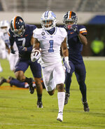 North Carolina defensive back Kyler McMichael (1) runs for a touchdown in front of Virginia defenders during an NCAA college football game Saturday, Oct. 31, 2020, in Charlottesville, Va. (Andrew Shurtleff/The Daily Progress via AP)