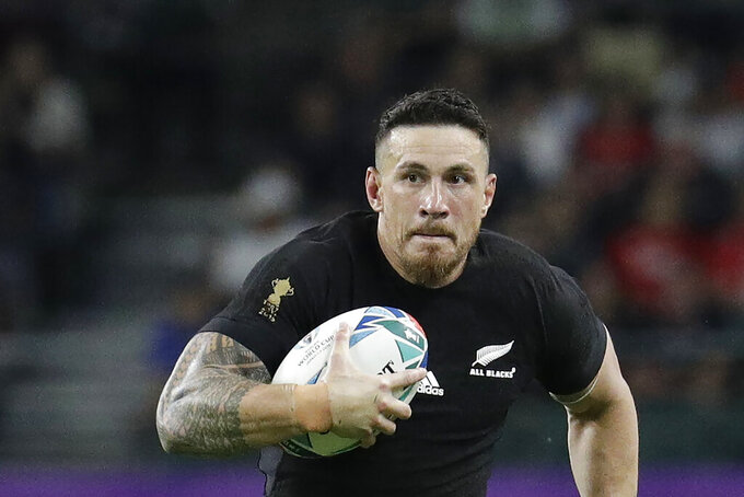 New Zealand's Sonny Bill Williams handles the ball during the Rugby World Cup Pool B game at Oita Stadium between New Zealand and Canada in Oita, Japan Oct. 2, 2019. Former New Zealand All Blacks star Williams is set to return to Australia's National Rugby League after last appearing in the code in 2014. (AP Photo/Aaron Favila)