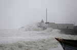 Waves crash on the coast of the Arabian Sea in Veraval, Gujarat, India, Thursday, June 13, 2019. Authorities have evacuated nearly 300,000 people from India's western coastline ahead of a very severe cyclone that's expected to make landfall as the year's second major storm. The India Meteorological Department says Cyclone Vayu, named after the Hindi word for wind, could glance the western state of Gujarat Thursday afternoon before returning to sea. (AP Photo/Ajit Solanki)