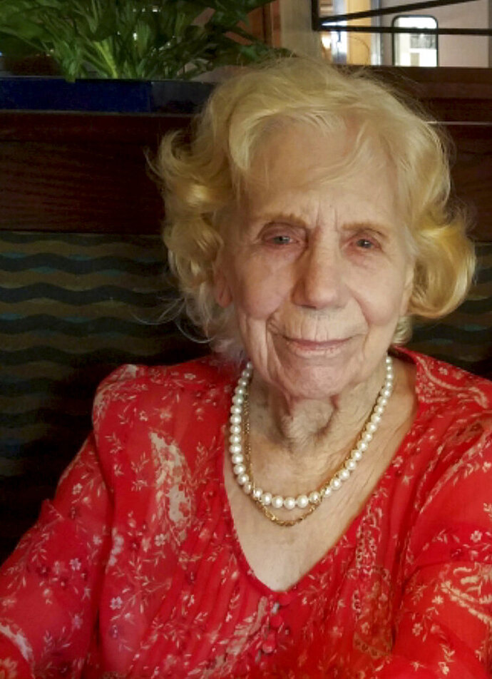 FILE - This Aug. 1, 2018, file photo provided by Arthur Lee shows his mother, Dorothy Lee Herrera, on her 93rd birthday in Chico, Calif. Authorities in Northern California have named Lee-Herrera as another victim of a 2018 wildfire in the town that killed 85. The Butte County sheriff's office say Lee-Herrera of Paradise died in the Camp Fire. Authorities officially identified Herrera Thursday, Feb. 21, 2019, but her family had previously said she died in her home along with her husband. (Arthur Lee via AP,File)
