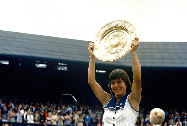 FILE - In this July 7, 1978, file photo, tennis star Martina Navratilova holds up her trophy after defeating Chris Evert in the women's singles final at Wimbledon. (AP Photo/File)