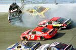 FILE - In this Feb. 18, 2001, file photo, Dale Earnhardt's (3) window pops out of the car after being hit by Ken Schrader (36) during the Daytona 500 auto race at Daytona International Speedway in Daytona Beach, Fla. On the cusp of a national popularity explosion, NASCAR never stopped after the deaths of Adam Petty, Kenny Irwin Jr. and Tony Roper. But losing Earnhardt forced the stock car series to confront safety issues it had been slow to even acknowledge, let alone address. The dramatic upgrades have saved multiple lives — NASCAR has not suffered a racing death in its three national series since — and are the hallmark of Earnhardt's legacy. (AP Photo/Greg Suvino, File)