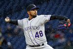 Colorado Rockies starting pitcher German Marquez delivers in the first inning of a baseball game against the Pittsburgh Pirates in Pittsburgh, Monday, April 16, 2018. (AP Photo/Gene J. Puskar)