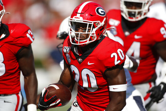 Georgia defensive back J.R. Reed (20) drives on for a touchdown after recovering a Murray State fumble in the first half of an NCAA college football game Saturday, Sept. 7, 2019, in Athens, Ga. (Joshua L. Jones/Athens Banner-Herald via AP)