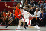 Utah guard Jaxon Brenchley (5) drives as Oregon State guard Gianni Hunt (0) defends in the first half during an NCAA college basketball game Thursday, Jan. 2, 2020, in Salt Lake City. (AP Photo/Rick Bowmer)