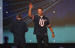 In this Friday, June 7, 2019 photo, Chicago Bears quarterback Mitch Trubisky is introduced during the Bears100 Celebration Weekend at the Donald E. Stephens Convention Center in Rosemont, Ill. (Chris Sweda/Chicago Tribune via AP)