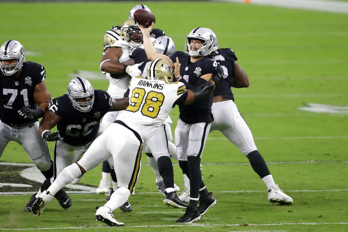 Las Vegas Raiders quarterback Derek Carr (4) throws the ball over New Orleans Saints defensive tackle Sheldon Rankins (98) during the first half of an NFL football game, Monday, Sept. 21, 2020, in Las Vegas. (AP Photo/Isaac Brekken)