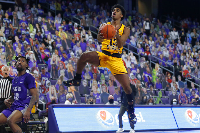 CORRECTS MONTH TO DECEMBER-Arizona State guard Josh Christopher (13) leaps to the basket past Grand Canyon's Jovan Blacksher Jr. after a turnover during the second half of an NCAA college basketball game, Sunday, Dec. 13, 2020, in Phoenix. (AP Photo/Ralph Freso)