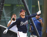 FILE - In this Thursday, Feb. 21, 2019 file photo, Atlanta Braves newly acquired third baseman Josh Donaldson smiles while watching the ball leave the park during batting practice at the team's spring training baseball facility in Kissimmee, Fla. In addition to defending champion Atlanta, the New York Mets, Philadelphia Phillies and Washington Nationals all have enough firepower to potentially contend for the playoffs. (Curtis Compton/Atlanta Journal-Constitution via AP, File)