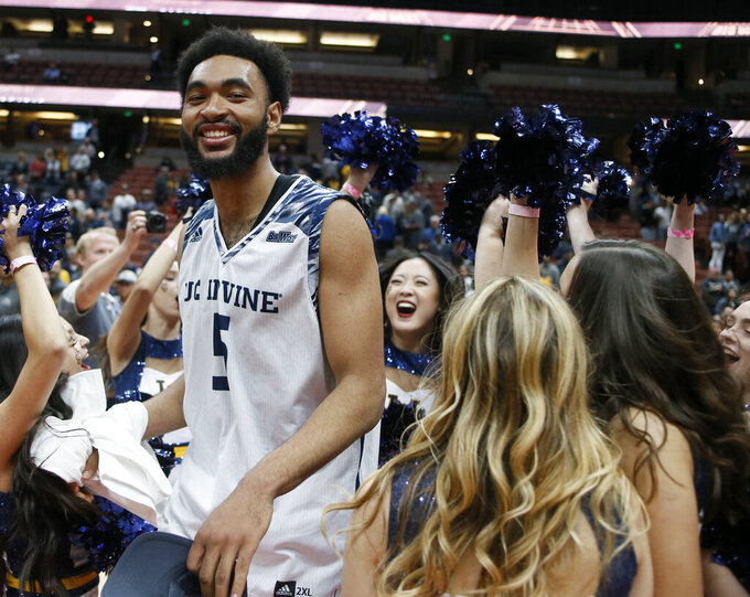 FILE- In this March 16, 2019, file photo UC Irvine forward Jonathan Galloway (5) dances with cheerleaders after his team defeated Cal State Fullerton during an NCAA college basketball game for the Big West men's tournament championship in Anaheim, Calif. (AP Photo/Alex Gallardo, File)
