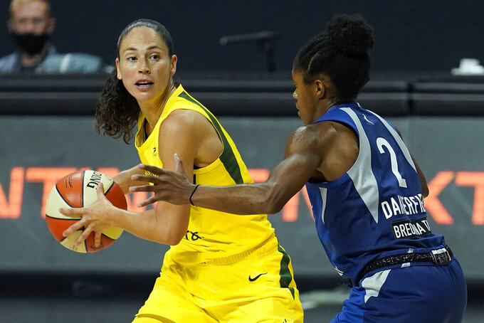 Seattle Storm guard Sue Bird (10) looks to pass around Minnesota Lynx guard Crystal Dangerfield (2) during the second half of Game 3 of a WNBA basketball semifinal round playoff series Sunday, Sept. 27, 2020, in Bradenton, Fla. (AP Photo/Chris O'Meara)