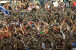 Government supporters flash heart-hand signals during the