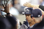 New York Yankees' Aaron Judge gestures to teammates as he celebrates with teammates in the dugout after hitting a two-run home run against the Texas Rangers in the third inning of a baseball game Wednesday, Sept. 4, 2019, in New York. (AP Photo/Kathy Willens)