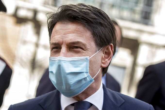 Italian Premier Giuseppe Conte leaves after addressing the Senate, in Rome, Thursday, April 30, 2020. Italy is in its eighth week of national lockdown to cope with COVID-19 emergency with some partial easing of restrictions on everyday life slated to take effect on Monday, with lifting of yet more limits set for later in coming weeks, on condition the rate of contagion doesn't sharply start rising again. (Roberto Monaldo/LaPresse via AP)