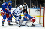 New York Rangers goalie Alexander Georgiev deflects a shot by Tampa Bay Lightning's Brayden Point during the first period of an NHL hockey game Wednesday, Feb. 27, 2019, at Madison Square Garden in New York. At letf is New York Rangers Fredrik Claesson. (AP Photo/Craig Ruttle)