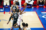 Philadelphia 76ers' Tyrese Maxey, right, goes up for a shot against Los Angeles Clippers' Patrick Patterson during the second half of an NBA basketball game, Friday, April 16, 2021, in Philadelphia. (AP Photo/Matt Slocum)