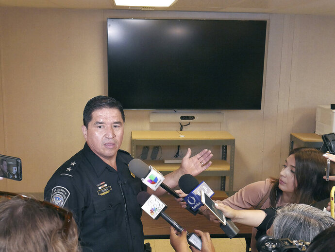 Customs and Border Protection Laredo Port Director, Albert Flores shows one of four Master Courtrooms where immigrants seeking asylum will face an asylum judge via a virtual video conference as members of the media were given a tour, Tuesday, September 10, 2019, of the Migrant Protection Protocols Immigration Hearing Facilities in Laredo, Texas. The facility is expected to start operations on Monday, September 16, 2019.  (Ricardo Santos/The Laredo Morning Times via AP)